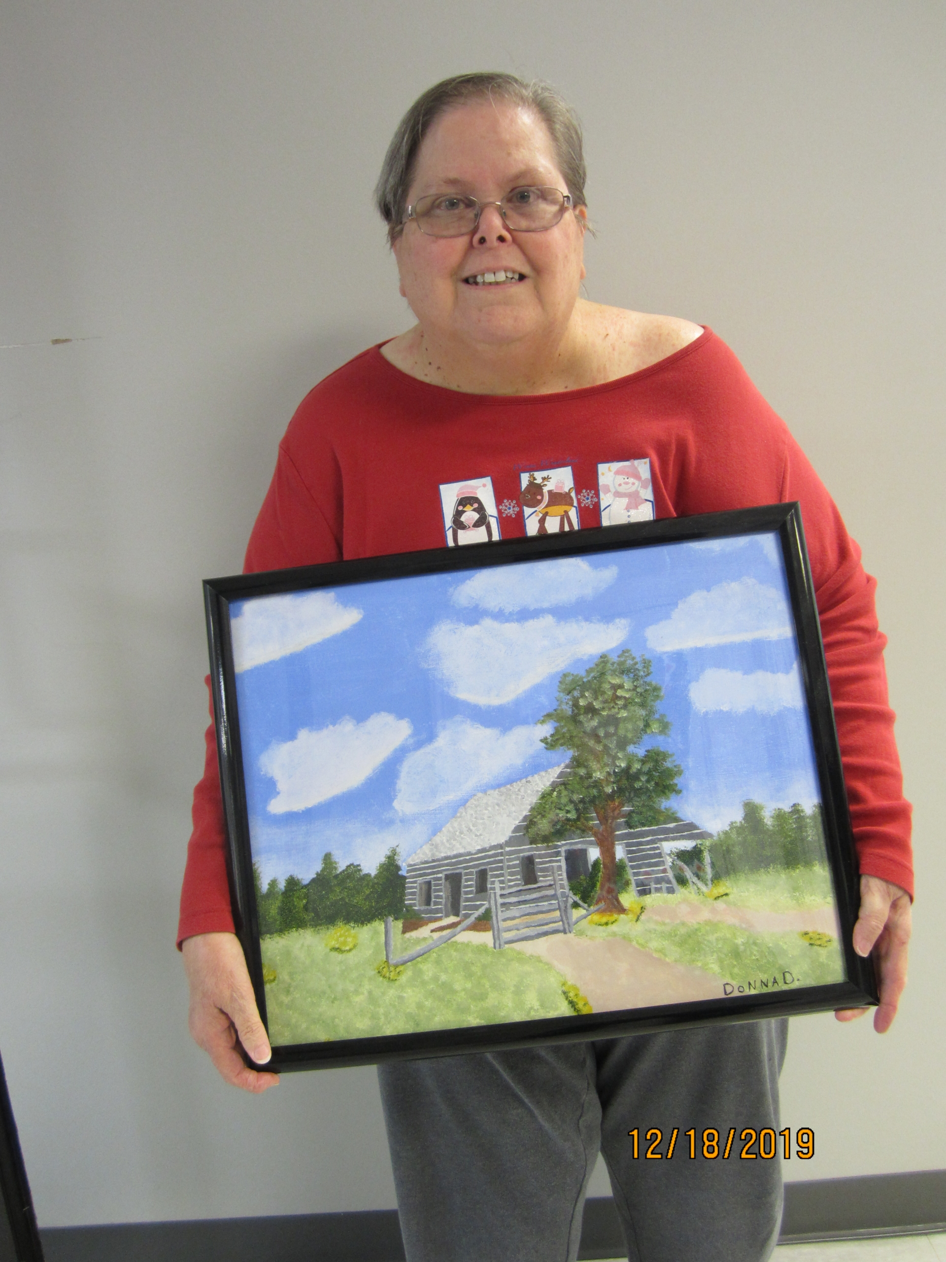 Woman holding her painting