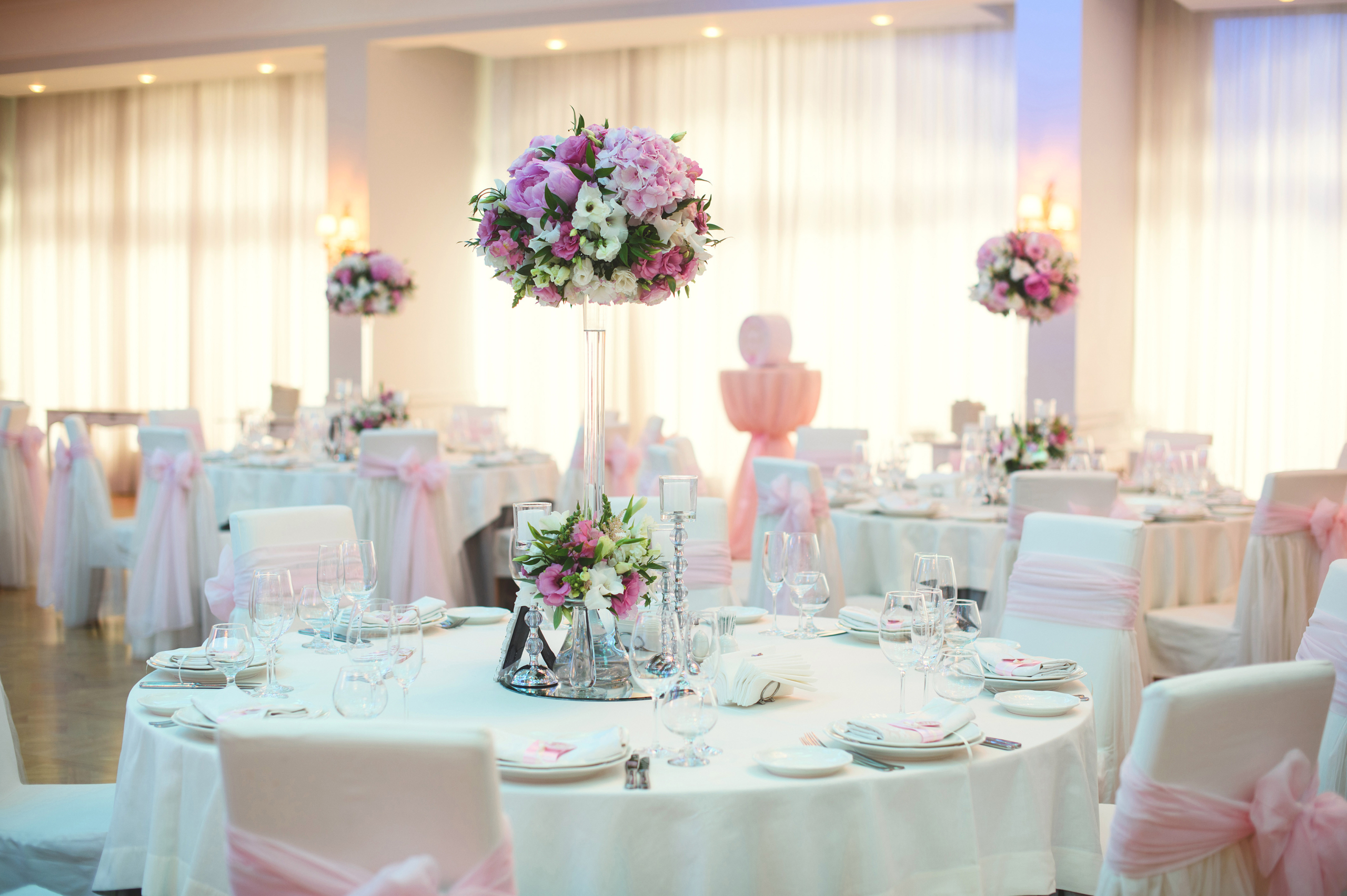 Restaurant Decorated with pink Flowers bouquets
